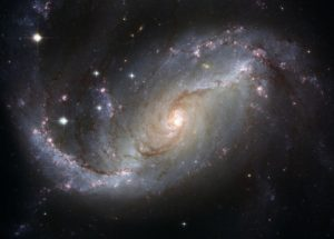 Spiral Galaxy in space with a central star