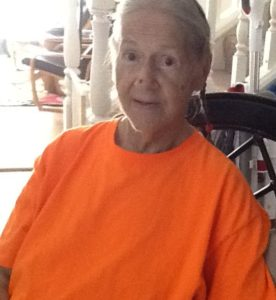 Mom with braided hair and an orange t-shirt.
