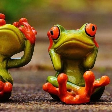 Three frogs in poses showing hear no evil, see no evil, speak no evil