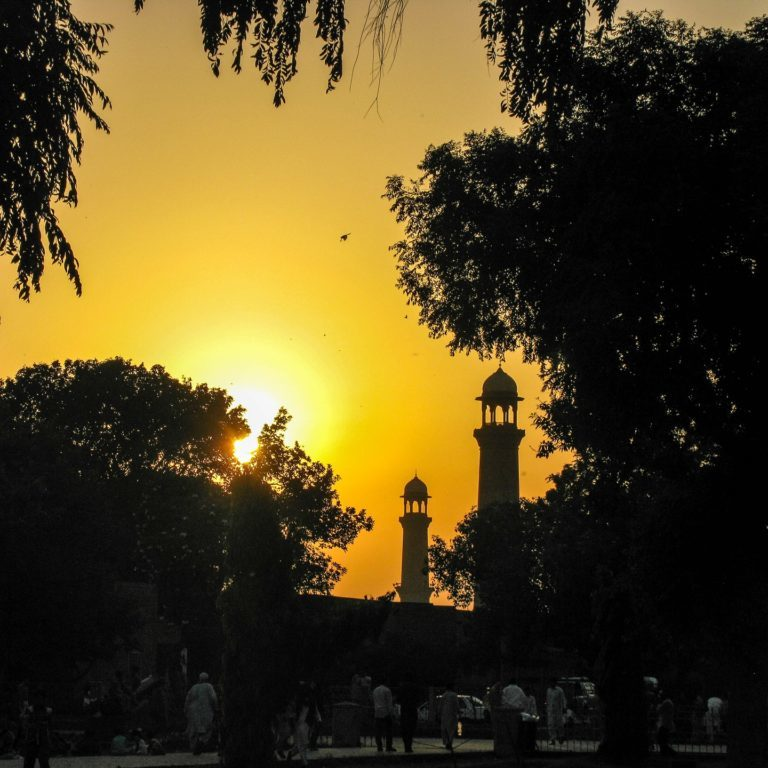 Setting sun behind the Minarets of a neighborhood Mosque